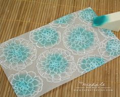Emboss flowers with white embossing powder. Ink center of flowers. Turn vellum over and attach to cardstock.  ***** Try with April stamps, best of butterflies