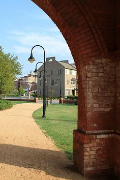 A view from within an archway of the Fayetteville Area Transportation Museum (Cape Fear and Yadkin Valley R.R. Depot, 1890), 325 Franklin Street.   Old and new structures alike reflect the architecture of early Fayetteville.    #FayettevilleNC