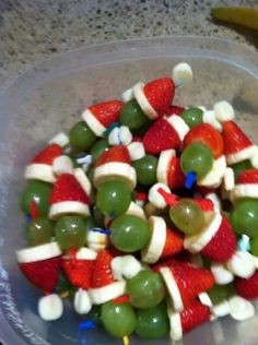 Grinch kabobs. Mini marshmallow,  strawberry, banana slice, and green grape.