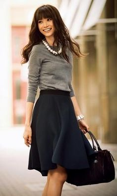 Wear a sweater with your summer skirt (if you don't have a winter skirt). Add a necklace for pop of color, done. midi skirts, sweater, full skirts, work looks, statement necklaces, circle skirts, offic, work outfits, chunky necklaces