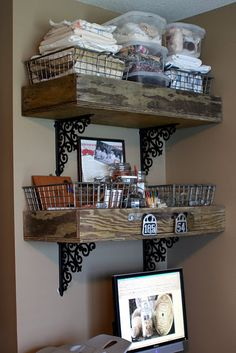 Wood boxes for shelves; also love the black iron scroll-design holders & wire baskets