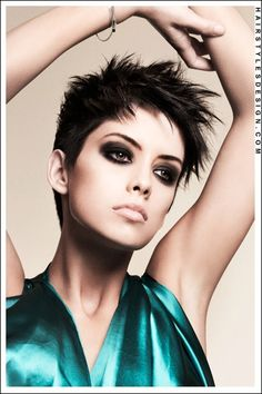 Hair Style: This hairstyle is both fun and flirty. This woman has her hair styled into this short spiky do. The hair has been layered and messed up all around.  Hair Cut: For this haircut, the hair is short.  Hair Colour: The hair colour is a medium ash brown.