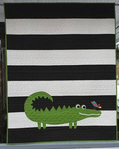 Striped baby quilt, could personalize it with applique name and different animal that starts with the same letter as the baby's name.