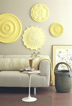 Ceiling rosettes as wall accents.  I think I can find these at Lowe's or Home Depot...cute!!