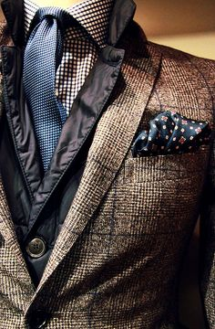 Layering dress shirt, knitted tie, quilted down jacket under a tweed sport jacket...