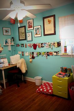 Turquoise Craft Room with green furniture