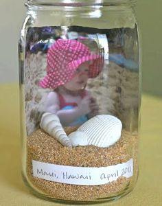 Vacation memory in a jar. Place sand, shells, etc. with a photo from the vacation.