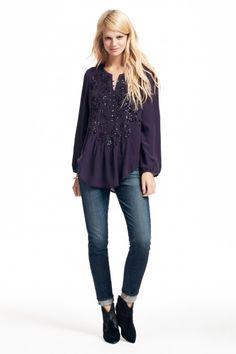 embellished silk blouse.