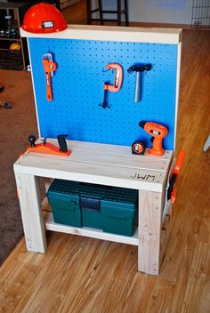 DIY | Play Workbench  Supplies list:  2x4s: $8.00 (used 3.5 boards)  Nails: $1.00 (lots extra)  Peg board: $2.79 (only used half)  Spray paint: $3.44 (lots left over!)  Large snaps: $3.99  Canvas scraps: $1.00    Total:  $20.22   (with nearly enough material left over to make another one!)