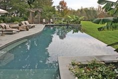 Swimming Pool with Sun Lounge Patio - After taking a dip, pool-goers can comfortably relax on the sun deck and take in the surrounding vista. Photo courtesy of Aquatech Society: Charlottesville Aquatics, Inc. http://www.luxurypools.com/builders-designers/aquatech-society.aspx