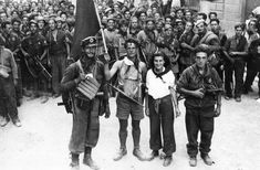 Florence, Italy, August 1944: Partisans face the camera after moving into the city. The star on their chests tells the story of their ideology. Note the three in the vanguard carrying British Sten guns.    Read more: http://www.histomil.com/viewtopic.php?f=340&t=13902#ixzz311bnKJA5