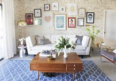 Joy Cho room styled by Emily Henderson. Love the vignette of artwork and varying patterns in the room.
