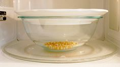 """Microwave Popcorn in a Bowl and Plate to Reduce Unpopped Kernels.....want a flavor treat? Use 1/2 stick of real butter, heat that first for about a minute, then add 1/3 cup of popcorn. Doesn't taste like traditional """"buttered popcorn"""", has a flavor of it's own, and is adicting. LOL"""