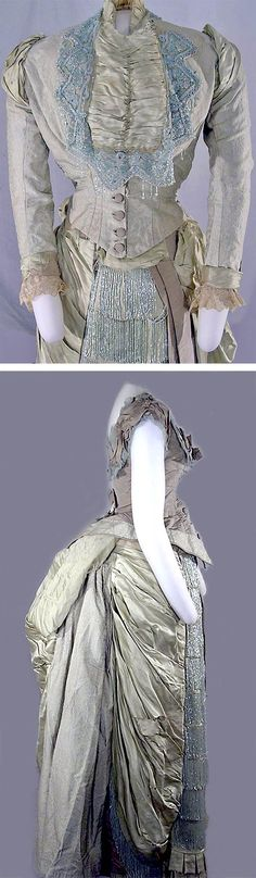 Three-piece dress, ca. 1870-89. Pale blue and white brocade faille and satin. Bodice of faille trimmed in brocade. Low neck, cap sleeves, net ruffles, points front and back, back buttons. Jacket with mandarin collar and jabot of satin with heavy bead trim; long sleeves with satin and lace trim. Skirt elaborately trimmed with satin and bead fringe. Satin and lace bustle; machine-made blonde lace on jacket bustle. Cornell Univ. Costume Collection