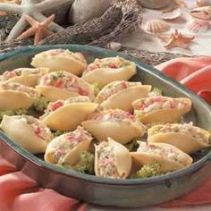 Crab-Salad Jumbo Shells ~ 30 jumbo pasta shells, 1 cup finely chopped broccoli, 1 garlic clove minced, 16 oz chopped imitation crab meat, 8 oz sour cream, 1/2 cup mayo, 1/4 cup finely shredded carrot, 1/4 cup diced seeded cucumber, 1 tbsp chopped green onion & 1 tsp dill weed
