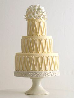 A yellow, modern wedding cake from TheKnot.com