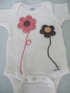 Putting crochet flowers and butterflies onto onesies.Includes ruffle bum onesie tutorial too.