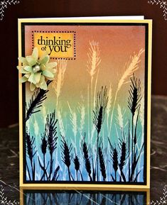 use a silhouette stamp, embossing resist technique, then the same stamp in black...great!