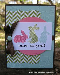 Embossed clouds form the background of this handmade Easter card that's all about the bunnies.  Great patterned paper really helps the bunnies stand out on the chevron green paper.