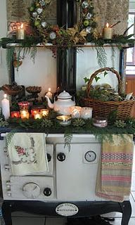My Stanley woodstove decorated for Christmas - I can do this because it is summer and the stove is not in use!
