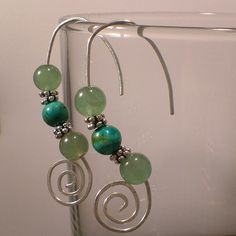 Dig how the ear wires are part of the fluid design.  Might put a loop or crimp above top bead.