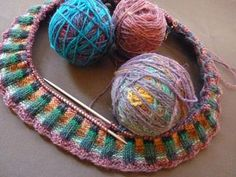 """The Feral Knitter talks you thru your first Magic Ball project -- """"Loosely tie lengths of yarn to each other, for a unique, self-striping yarn that reveals itself as you knit. You can use different textures, different weights, and most definitely different colors. The trick is to avoid the scrappy look, to provide some structure to the design. This can be accomplished through controling values, limiting hues, use of solid colors, and the careful choice of pattern."""" Click for more."""
