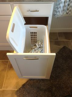 Pull-out hamper in the master bath. Great storage idea!