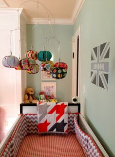 This colorful paper #mobile adds so much life in this #nursery.  #red #aqua #gray
