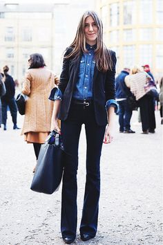 There are endless ideas for how to style a blazer this fall like this cuffed denim shirt and black blazer duo.