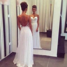 Low back, thin straps, form hugging... It would be perfect with a long train