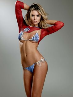 In honor of the #WorldCup, #tbt to when we invited soccer WAGs to get body painted for our 2010 issue! Abbey Clancy, wife of Peter Crouch, killed it.
