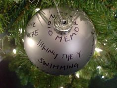 Fun idea... buy a large, dollar store ornament, sit down with kids and a sharpie and write the memories from that year on the ornament.