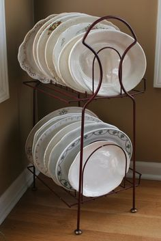 DIY Upcycled Album/Record Rack purchased for $1 is put to use in a Rustic Farmhouse as Storage for Large Platters and Hard-To-Fit Dishes! Excellent use of $1!!!