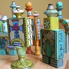 Artwork made into painted wood sculptures using vintage blocks and spools, candle holders, dresser knobs and more!  Each one is unique!