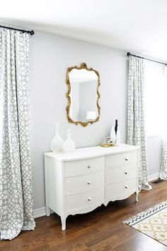 Master Bedroom, West Elm Shane Powers Opal Vases, Gold leaf scroll mirror, white French dresser, Windsor Smith Pelagos drapes
