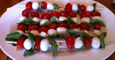 Need a quick appetizer for a Christmas Party? This one is super easy and very festive!   You will need the following:  Skewers  Grape tomatoes  Bocconcini di mozzarella  Fresh basil  They are beautiful and very tasty!
