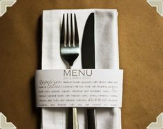 Menu on band of paper serves as napkin ring. This would be an easy DIY project, though these are custom printed.  Hayley, for your saying??  (But we would make them napkin rings unless you like this better)