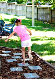 Entertain the kids with a DIY hopscotch garden path!  This started as a clever way to deal with a patch of backyard where the grass simply wouldn't grow. Click through to read more on Our Fifth House.    @ourfifthhouse
