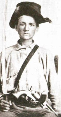 Young Confederate, Alabama Cavalry. His revolver is almost bigger than he is !