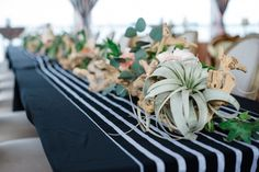 Striped runners with driftwood centerpieces