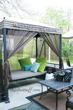 Love this canopy swing makeover by @DIY Show Off . See how she added the drapes!