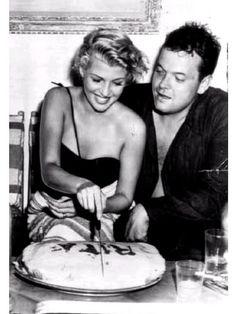 Orson Wells and Rita Hayworth celebrate the beautiful starlet's birthday aboard Errol Flynn's yatch.}
