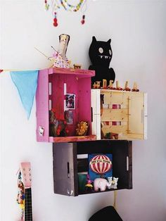 Instant and fun shelving for a child's room.  Painted, stacked and embellished with toys or collections these fruit crates look super.