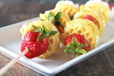 mini waffles, strawberries and whip cream on a stick