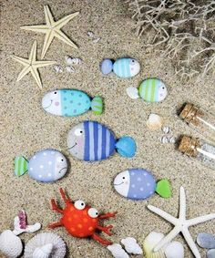 DIY Summer Kids Crafts that uses rocks and stones to create fish in your backyard. I still have theses from last year when my kids made them, super cute fish rock, diy summer kids crafts, summer kid crafts, rock crafts, stone, rock art, painted rocks, bathroom