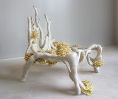 Myceliumchair by Eric Klarenbeek. Klarenbeek is exploring ways of 3D-printing living organisms, such as mycelium, the threadlike network of fungi, in combination with local raw materials to create products with a negative carbon footprint.