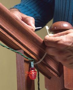 Zip ties are easy and inexpensive ~ Zip ties are a simple way to string holiday lights on banisters and fences without marring the railing with nail marks. A pack of 20 zip ties costs 1.60 at home centers. You'll find them in the electrical supplies aisle. After the holidays, snip the ties off with scissors.