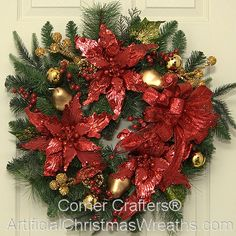 Christmas Elegance Wreath - 2013 - Our lovely Christmas Elegance Wreath will add a regal beauty and color to your Christmas decorating. Beautiful Poinsettias and Christmas Ornaments decorate this wonderful Christmas wreath. A lovely bow adds the right finishing touch. #ArtificialChristmasWreaths #ChristmasWreaths #Wreath #Wreaths #Christmas