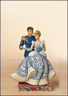 """Heartwood Creek by Jim Shore Disney Traditions  ROYAL ROMANCE  As the story is told, the night Cinderella met Prince Charming at the ball, she also lost her glass slipper. This """"Royal Romance"""" figurine depicts the moment they are united through music andfell in love. Just in time for Valentine's Day, this is part of the 'Disney Princesses' theme brought to life by Jim Shore. Make sure to collect them all!    $35.00"""