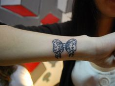 Leopard print bow tattoo